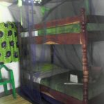 Mosquito net over bunk beds