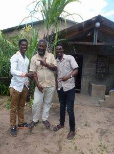 Emanuel (left), Dad Fredrick (centre) Matindo (right)