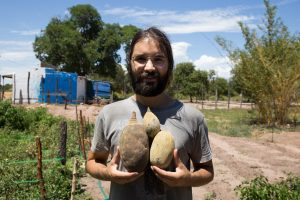 Afonso with Baobab seed pods